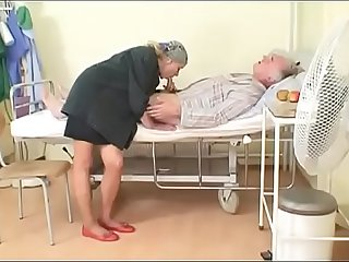 Sexy young nurse gives a blow job to an old pig in hospital